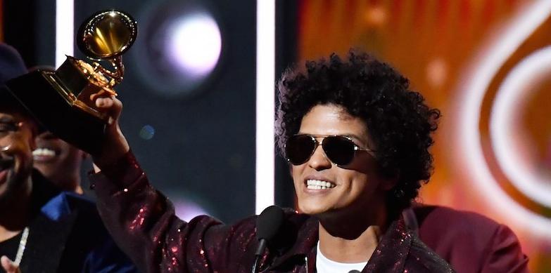 Bruno Mars holding a grammy